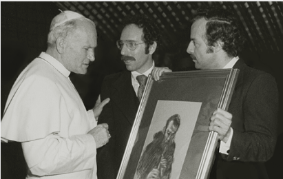 "Blessed Pope John-Paul II receiving a gift of the drawing ""Brother Florian Playing the Recorder,"" Tyniec Abbey, Poland, from the artist Stanley Roseman and his colleague Ronald Davis, Vatican, 1979."