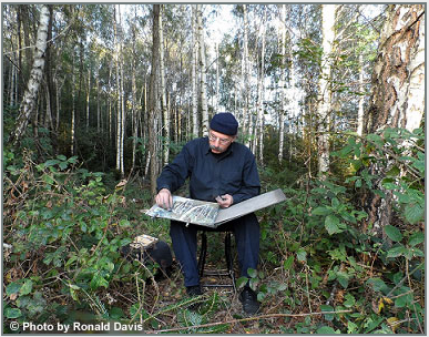 Stanley Roseman drawing in a grove of birches, France, 2012. © Photo by Ronald Davis