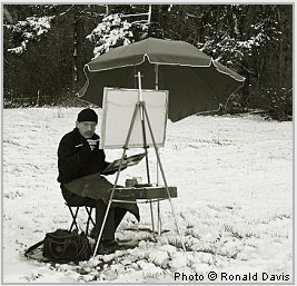 Stanley Roseman at his easel in a snowy field in the French countryside, 2007. © Photo by Ronald Davis