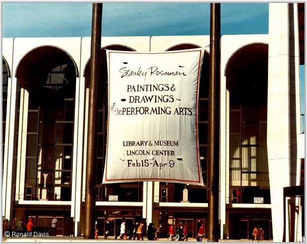 "Lincoln Center Plaza with the banner announcing the exhibition ""Stanley Roseman - The Performing Arts in America"" at the Library and Museum of the Performing Arts, Lincoln Center, New York City, 1977. © Ronald Davis"