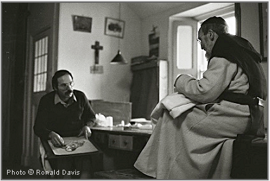 Photo of Stanley Roseman drawing Brother Michael, the tailor, in his workroom at Mount Melleray Abbey, County Waterford, Ireland, 1983. © Photo Ronald Davis