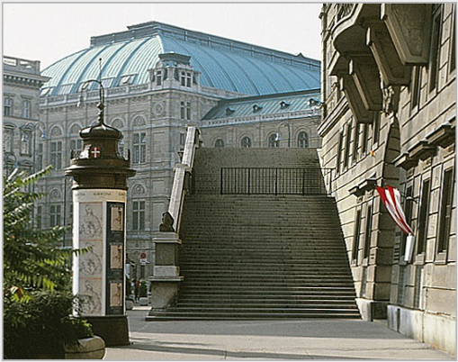 "Entrance to the Albertina (right), Vienna. Column with posters announcing the museum's exhibitions ""Raphael in der Albertina"" and ""Stanley Roseman - Zeichnungen aus Klostern,"" 1983. © Photo by Ronald Davis."